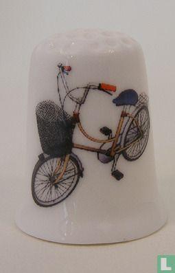 Fiets met fietsmand vingerhoedje
