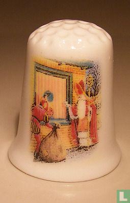 Sinterklaas klopt op raam bedrukt op een porselein vingerhoedje