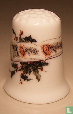 A joyful Christmas bedrukt op een porselein vingerhoedje