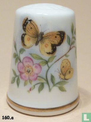 Vlinder op bloemen - Image 1