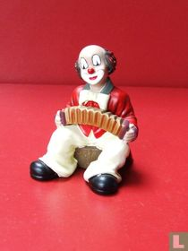 Clown met accordeon