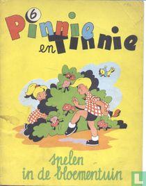 Pinnie en Tinnie spelen in de bloementuin