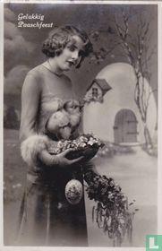 Gelukkig Paaschfeest - Jonge vrouw met paasatributen