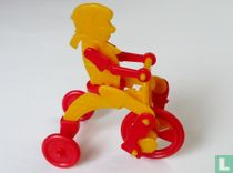 Man on tricycle
