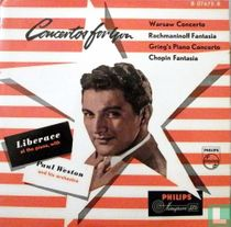 Liberace at the piano, with Paul weston and his Orchestra