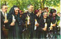 Scherpenheuvel - Bedevaartgangers volgen de Processie met hun kaarsen