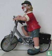 Fiets met clown erop (De fietser)