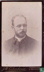 Priest with moustache, beard and glasses