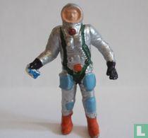 Astronaut mit Metallsucher