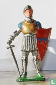 Knight standing with sword and shield