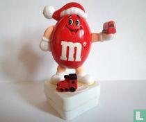 Rode M&M als kerstman met trein