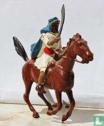 Arab on horse with scimitar blue cloak
