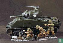 Three defenders with machine gun