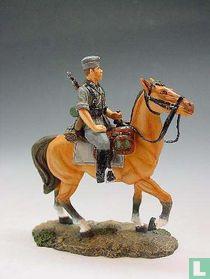 Schutter te paard met zijkap die naar links draait