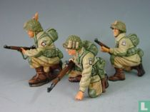 Three Kneeling US Paratroopers in Action
