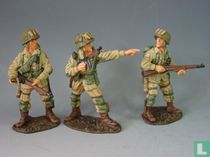 Three Standing US Paratroopers in Action