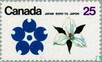 Emblem Expo '70 and white Garden Lily Blossom