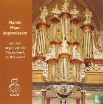 Improviseert aan het orgel van de Martinikerk te Bolsward  (1)