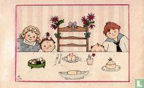 Vier kinderen bij een versierde stoel