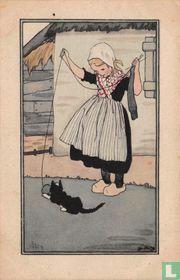 Meisje in klederdracht met poes met knot wol