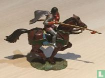 Knight on horseback with lance and cape
