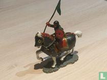 Ridder te paard met vaandel en cape
