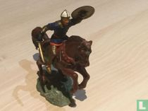 Horseman with shield in the air and sword