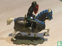 Ridder te paard met zwaard en harnas