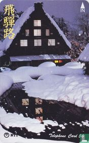 Lighted House in Snow