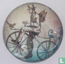 Man op ouderwetse fiets