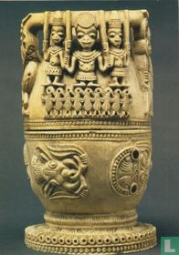Jug with carved human and animal figures