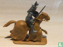 Koning te paard met zwaard